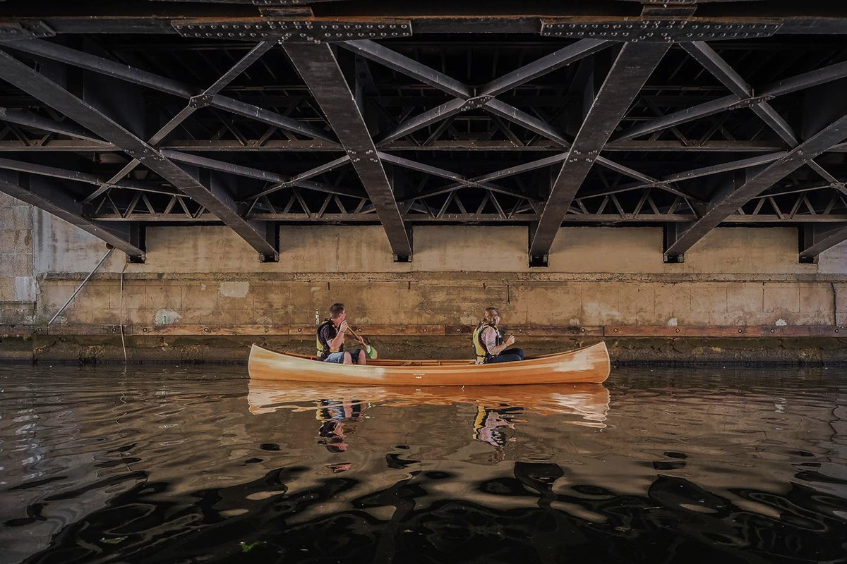 canoe under the bridge